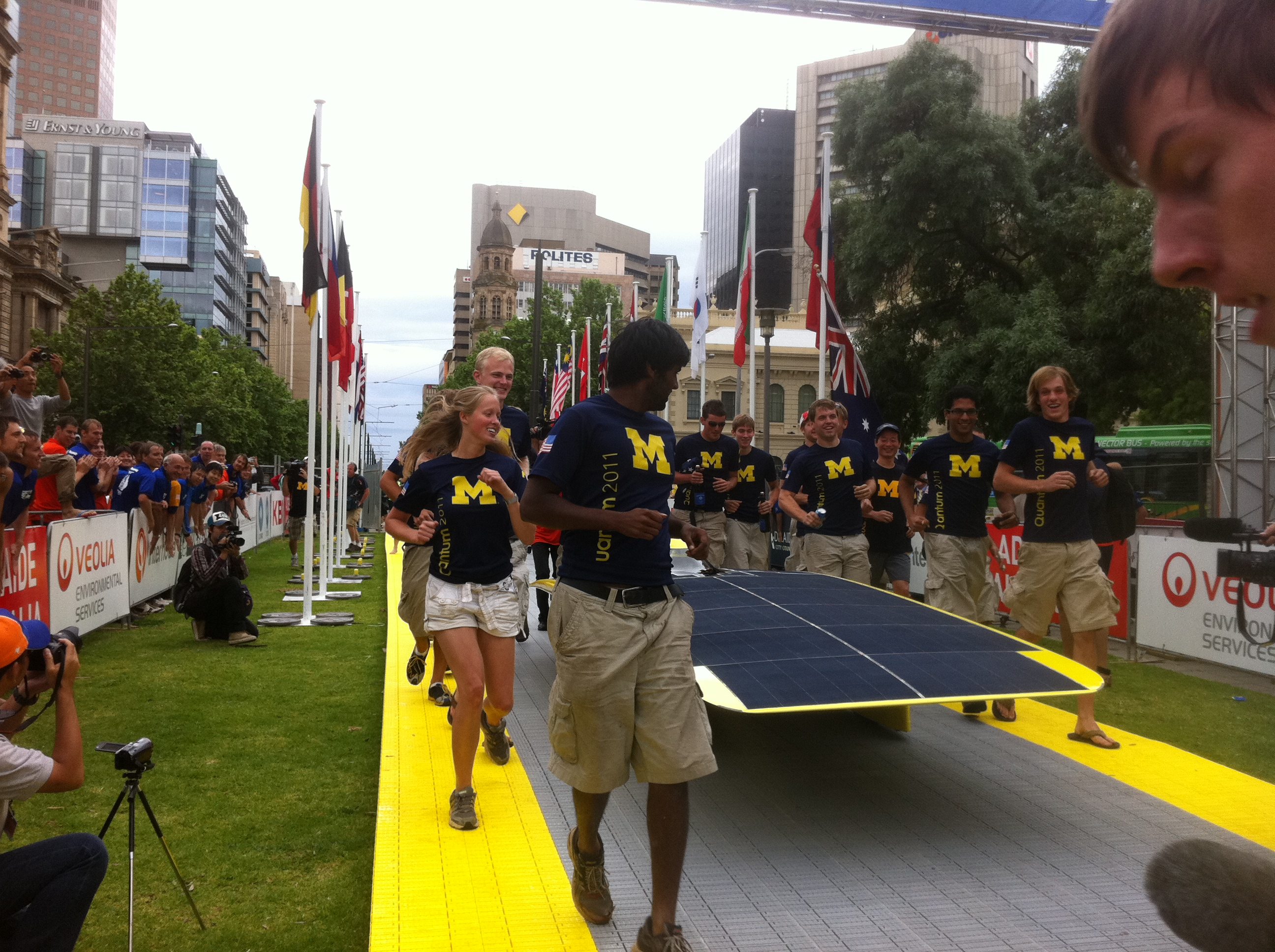 Quantum being escorted by University of Michigan team members