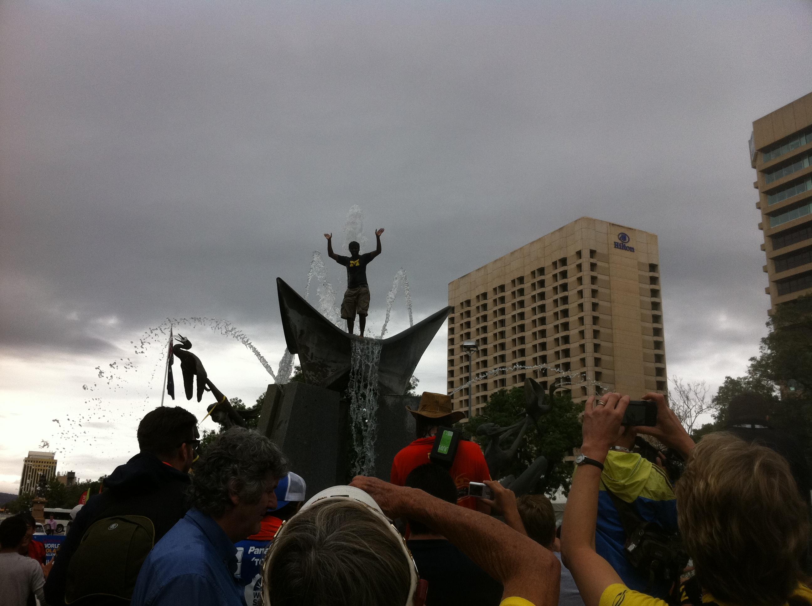 University of MI or Quantum team member reaching the top of the Victoria Fountain