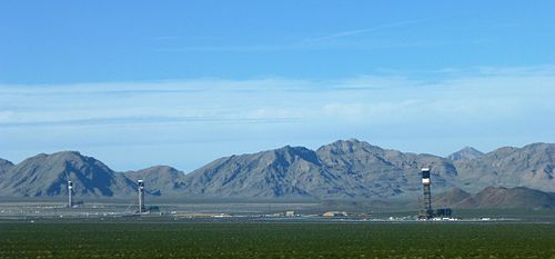 Ivanpah Solar Electric Generating System from Yates Well Road, The Clark Mountain Range can be seen in the distance.