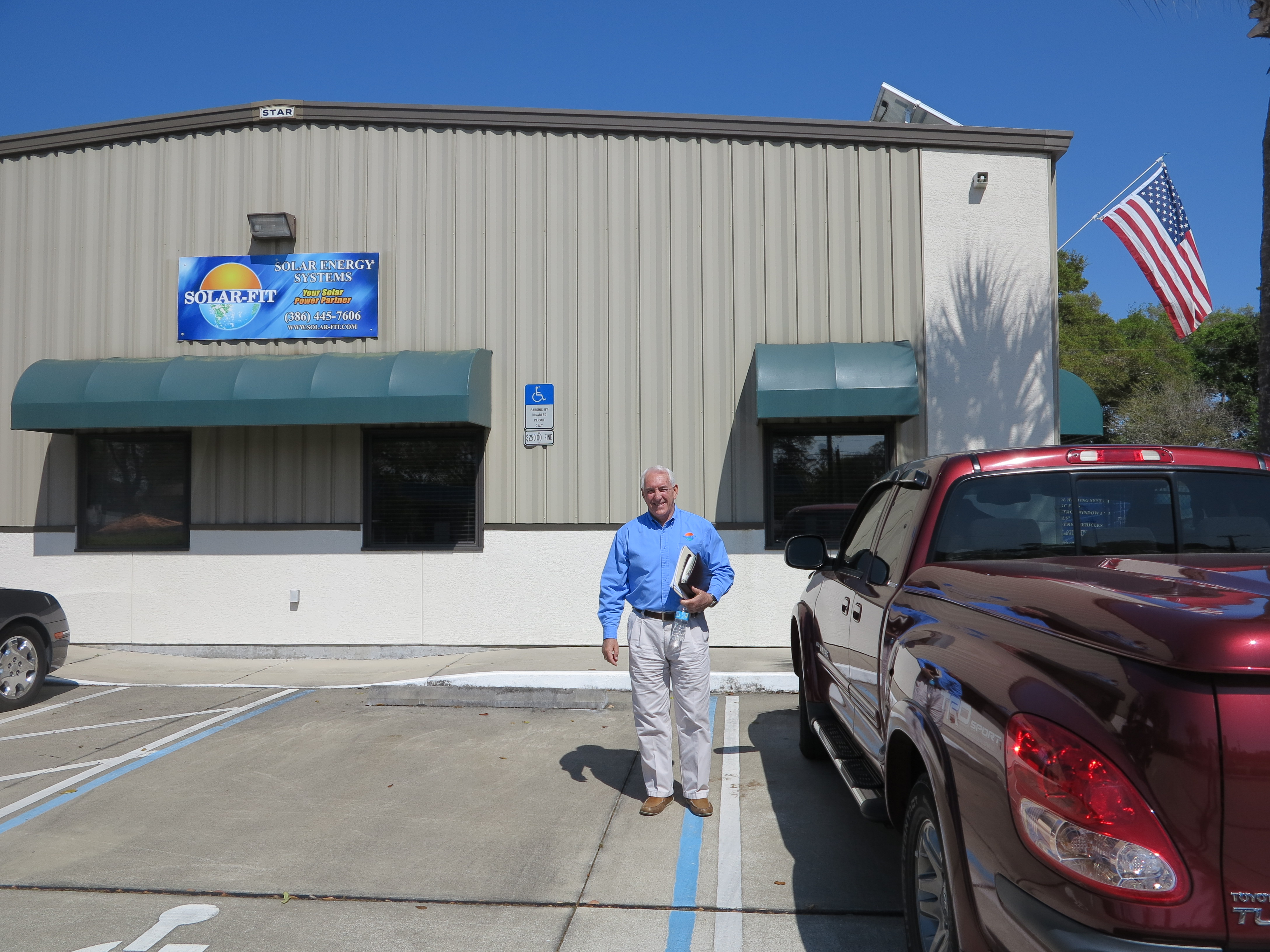 Bill Gallagher in front of  SOLAR-FIT of Holly Hill FL