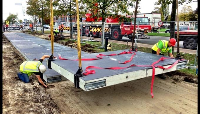 Solar Bikepath of Netherland, first in the world, being installed in Nov. of 2014 (credit: npr.org)