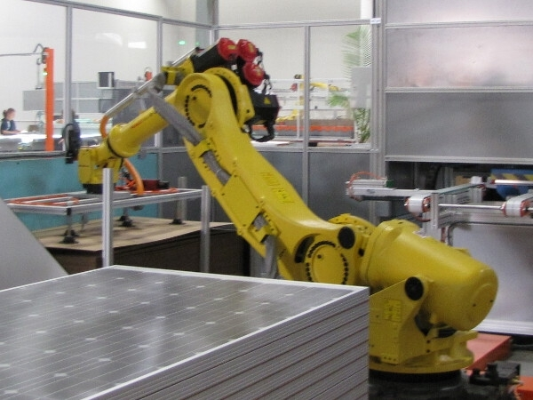 Helios Solar Works-A robot works on crystalline solar cells at Wisconsin-based Helios USA, LLC. (credit: Helios Solar Works LLC)